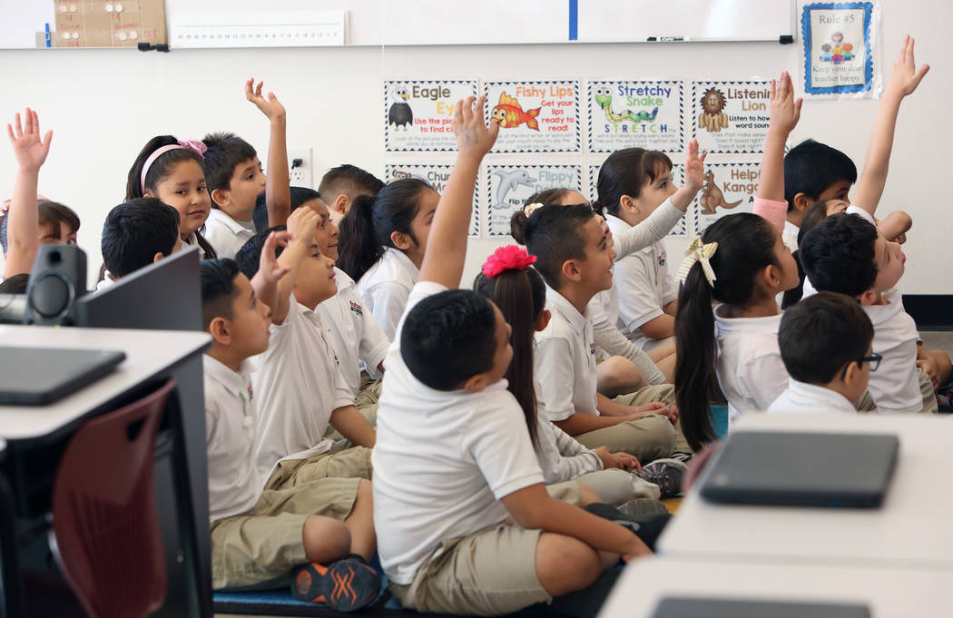 First grade students at Futuro Academy raise their hands to answer questions,  Thursday, Nov. 9, 2017, in Las Vegas. Bizuayehu Tesfaye/Las Vegas Review-Journal @bizutesfaye