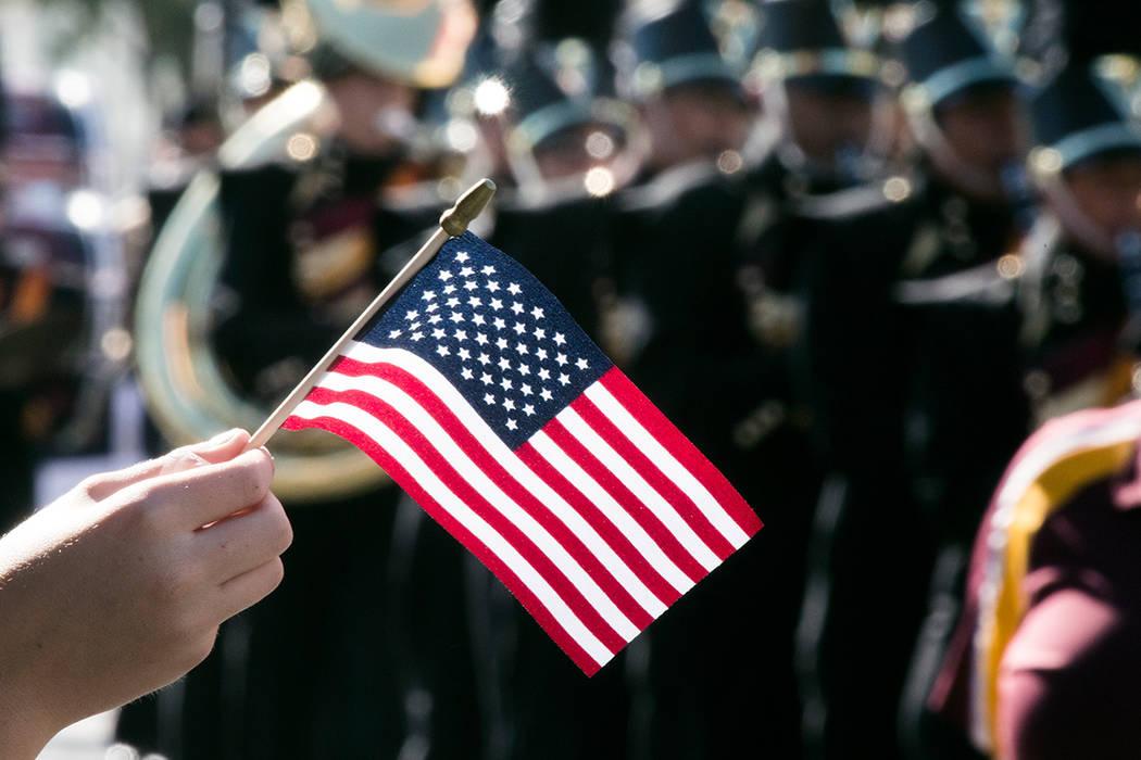 A boy waves an American flag during the Veterans Day Parade on 4th Street in downtown Las Vegas on Friday, Nov., 11, 2016. Jeff Scheid/Las Vegas Review-Journal Follow @jeffscheid