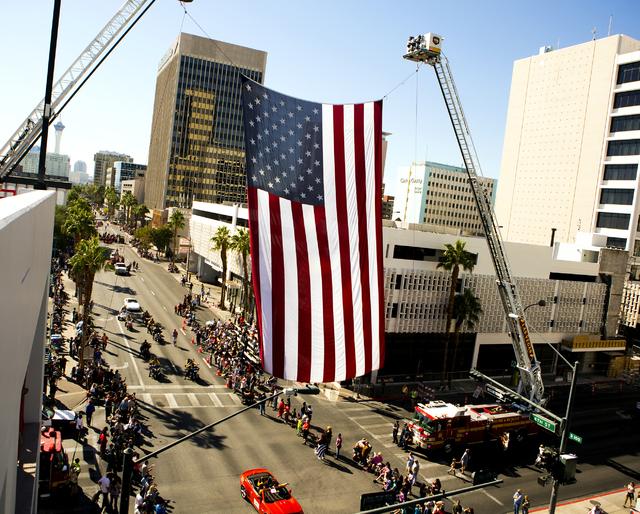 An American flag hangs over 4th Street during the Veterans Day Parade in downtown Las Vegas on Friday, Nov., 11, 2016. Jeff Scheid/Las Vegas Review-Journal Follow @jeffscheid
