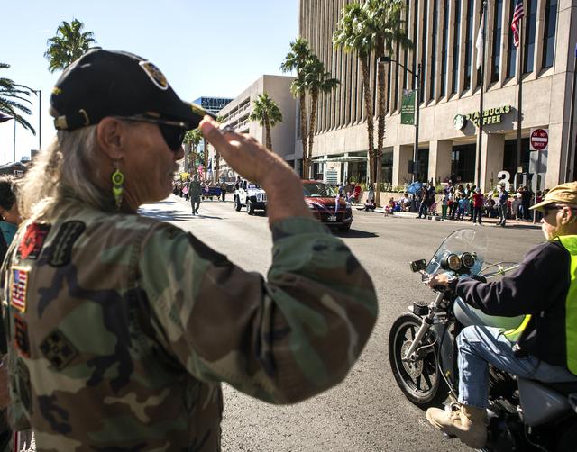 Vietnam veteran Gary D. Walker salutes fellow veterans during the Veterans Day Parade in downtown Las Vegas on Friday, Nov., 11, 2016. Jeff Scheid/Las Vegas Review-Journal Follow @jeffscheid