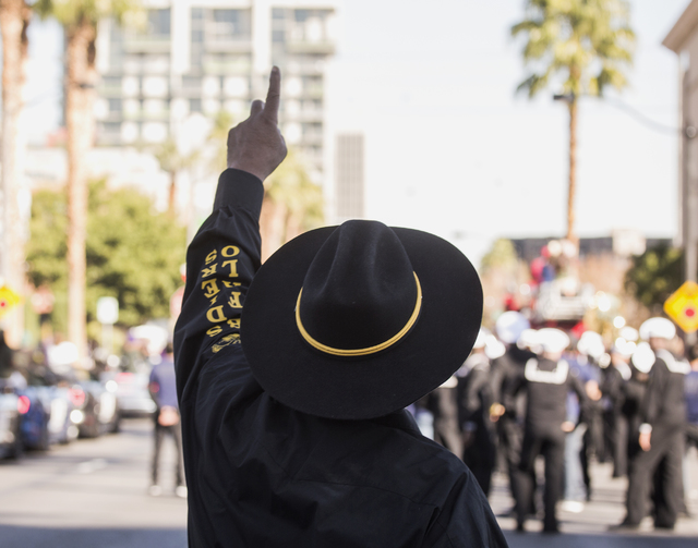 A member of the Buffalo Soldiers points to a F-35 fighter jet doing a flyover during the Veterans Day Parade in downtown Las Vegas on Friday, Nov., 11, 2016. Jeff Scheid/Las Vegas Review-Journal F ...