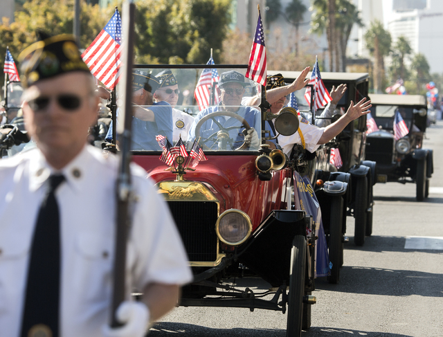 Members of American Legion Post 76 wave to the crowd on 4th Street during the Veterans Day Parade in downtown Las Vegas on Friday, Nov., 11, 2016. Jeff Scheid/Las Vegas Review-Journal Follow @jeff ...