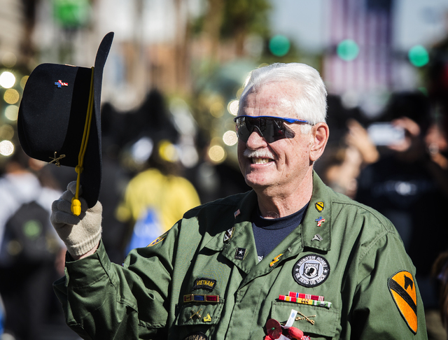 Vietnam veteran Jeff Dwyer tips his hat to other veterans during the Veterans Day Parade on 4th Street in downtown Las Vegas on Friday, Nov., 11, 2016. Jeff Scheid/Las Vegas Review-Journal Follow  ...