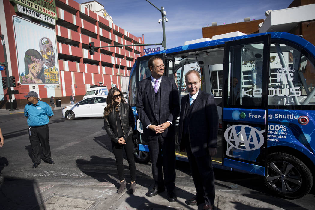 NASCAR driver Danica Patrick, from left, with magicians Penn Jillette, and Raymond Teller of Penn and Teller, during the launch event of a driverless electric shuttle at the Container Park in Las  ...