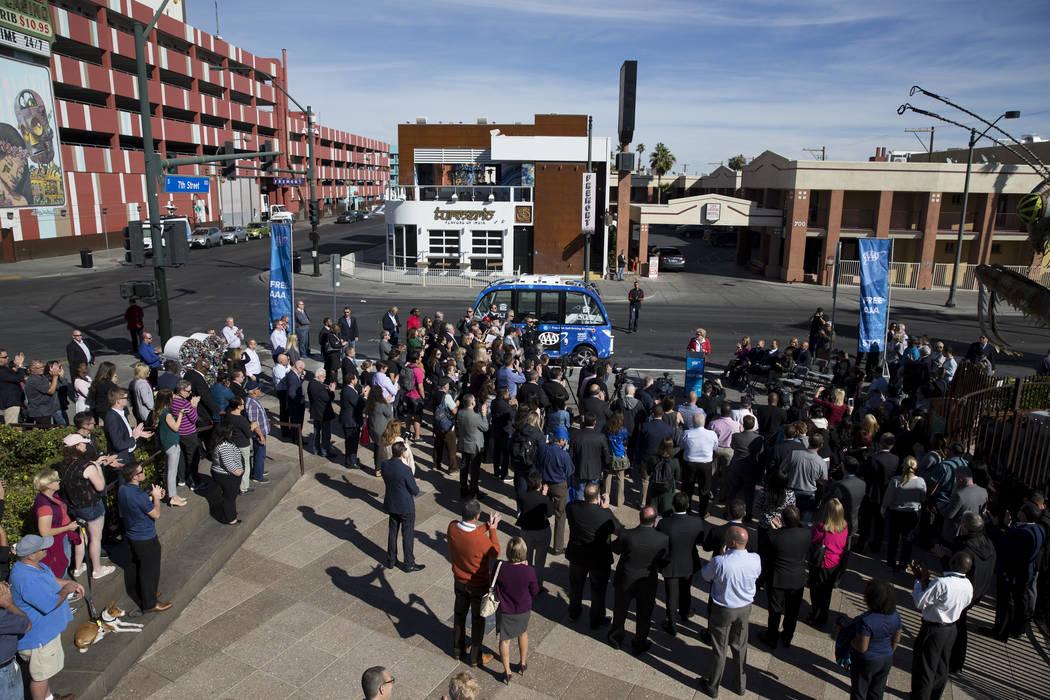 People attend the launch event of the driverless electric shuttle at the Container Park in Las Vegas, Wednesday, Nov. 8, 2017. Erik Verduzco Las Vegas Review-Journal @Erik_Verduzco