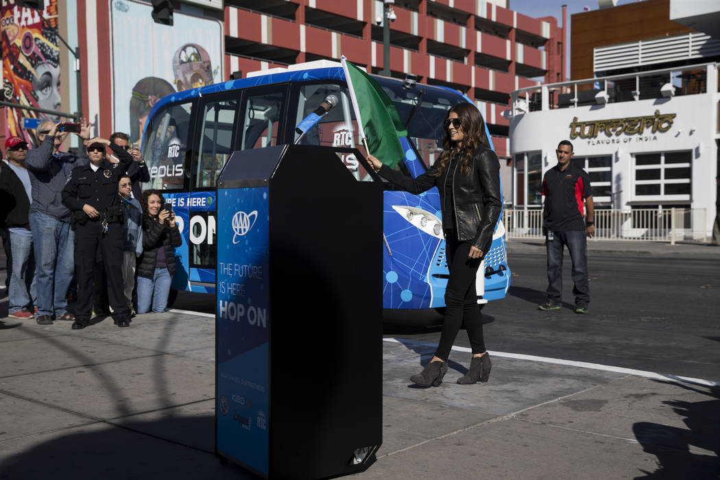 NASCAR driver Danica Patrick waves the green flag during a launch event of a driverless electric shuttle at the Container Park in Las Vegas, Wednesday, Nov. 8, 2017. Erik Verduzco Las Vegas Review ...