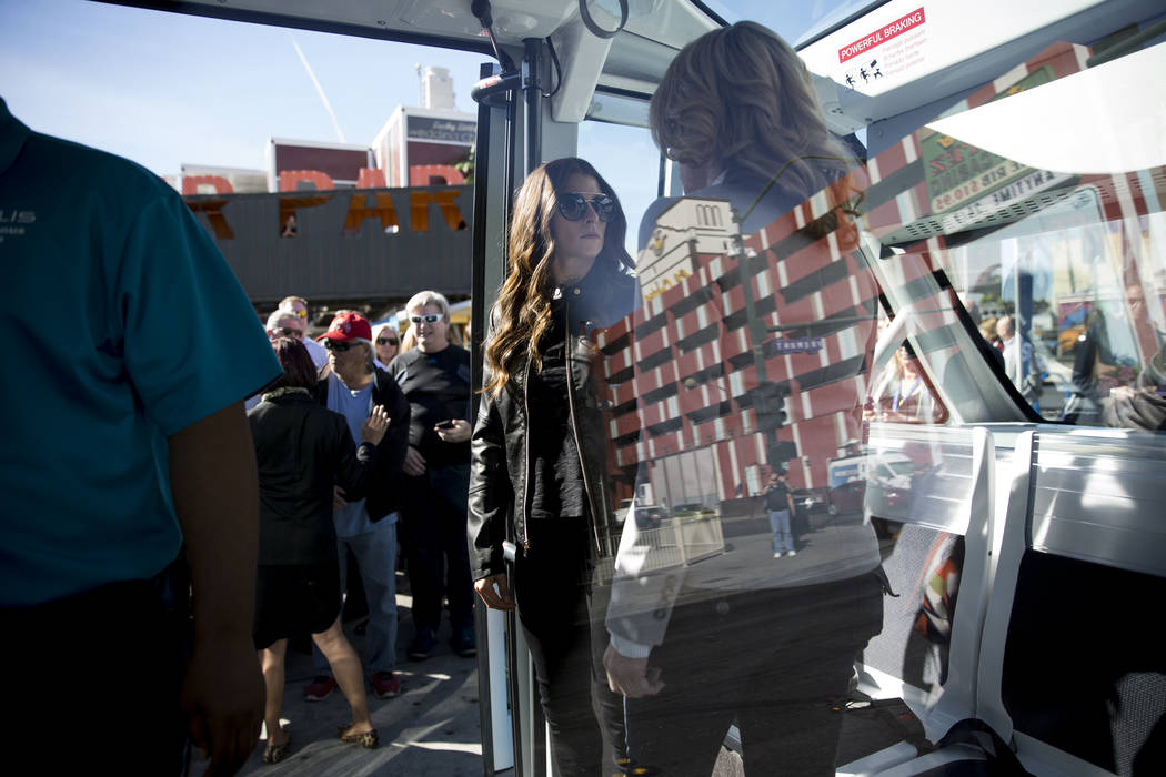 NASCAR driver Danica Patrick, center, on board of a driverless electric shuttle during a launch event at the Container Park in Las Vegas, Wednesday, Nov. 8, 2017. Erik Verduzco Las Vegas Review-Jo ...