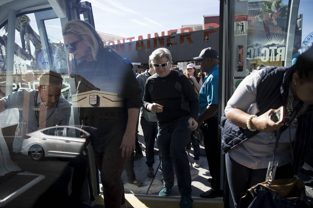 People board of a driverless electric shuttle during a launch event at the Container Park in Las Vegas, Wednesday, Nov. 8, 2017. Erik Verduzco Las Vegas Review-Journal @Erik_Verduzco