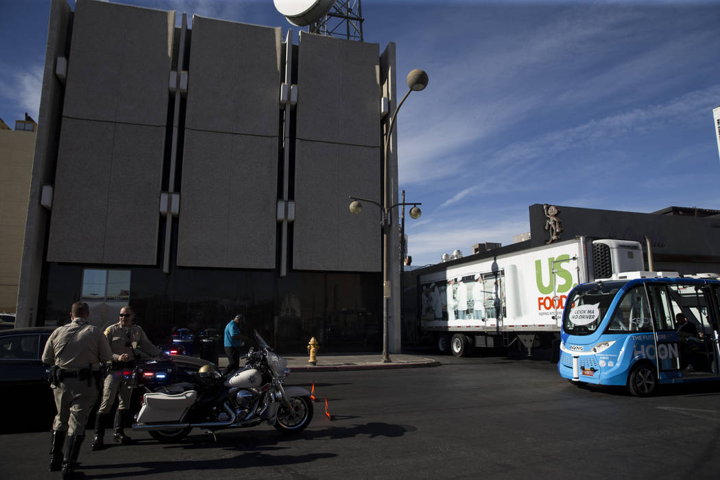 The scene of an accident between a truck and a driverless electric shuttle near Fremont Street and S. 6th Street in Las Vegas during the launch day of the autonomous vehicle, Wednesday, Nov. 8, 20 ...