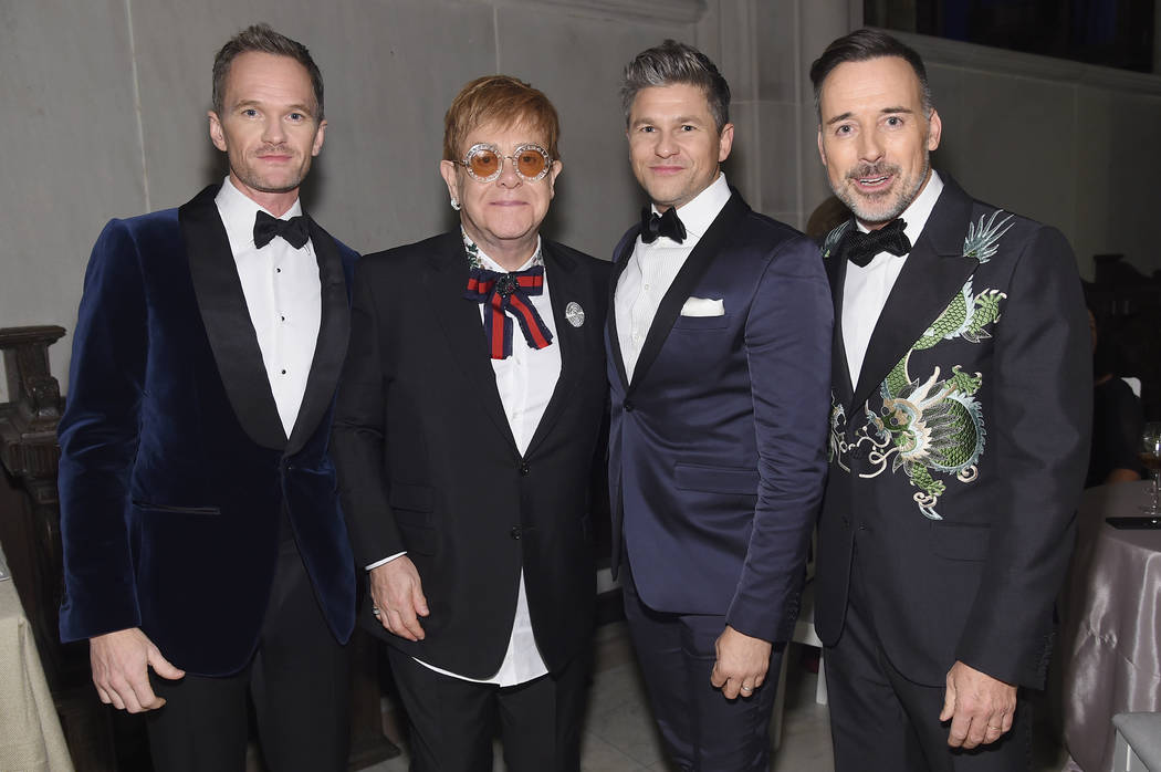 Neil Patrick Harris, Sir Elton John, David Burtka, and David Furnish attend the Elton John AIDS Foundation's 25th year anniversary gala at Cathedral of St. John the Divine on Nov. 7 in New York Ci ...