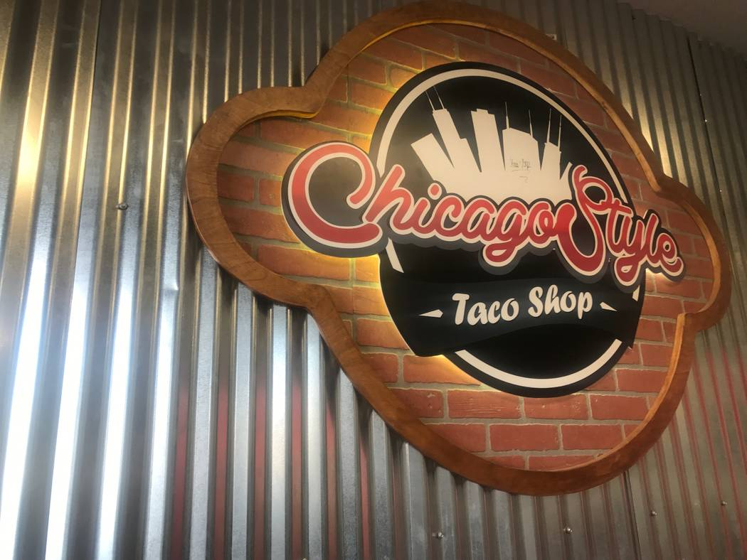 A sign is displayed on the wall at Chicago Style Taco Shop at 3415 W. Craig Road. (Kailyn Brown/View) @KailynHype