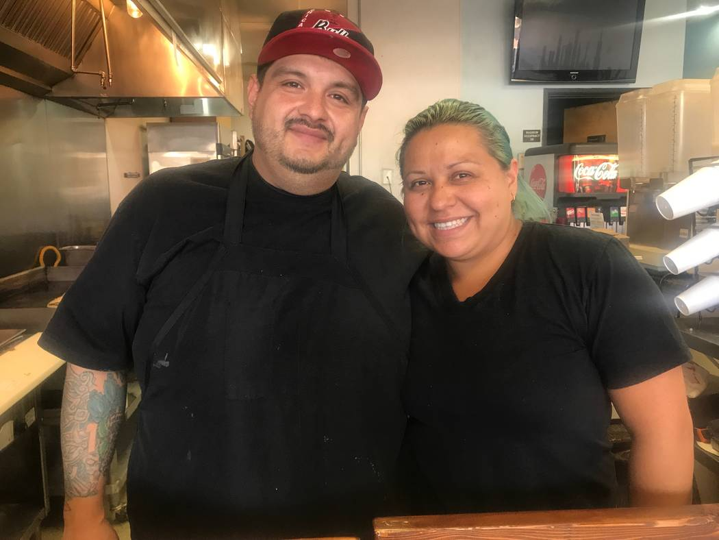 Owner Jose Garcia and his wife, Maria Ortega, pose for a portrait on November 8, 2017 at Chicago Style Taco Shop at 3415 W. Craig Road. (Kailyn Brown/View) @KailynHype