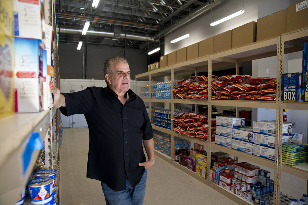 Veterans Village President Arnold Stalk stands in a food pantry filled with donated items at the newly established Veterans Village Crisis Intervention Center in Las Vegas on Friday, Nov. 10, 2017 ...