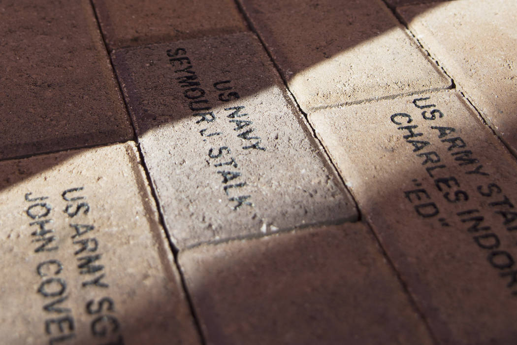 Bricks with the names of veterans and donors engraved on them are seen in the courtyard of the newly established Veterans Village Crisis Intervention Center in Las Vegas on Friday, Nov. 10, 2017.  ...