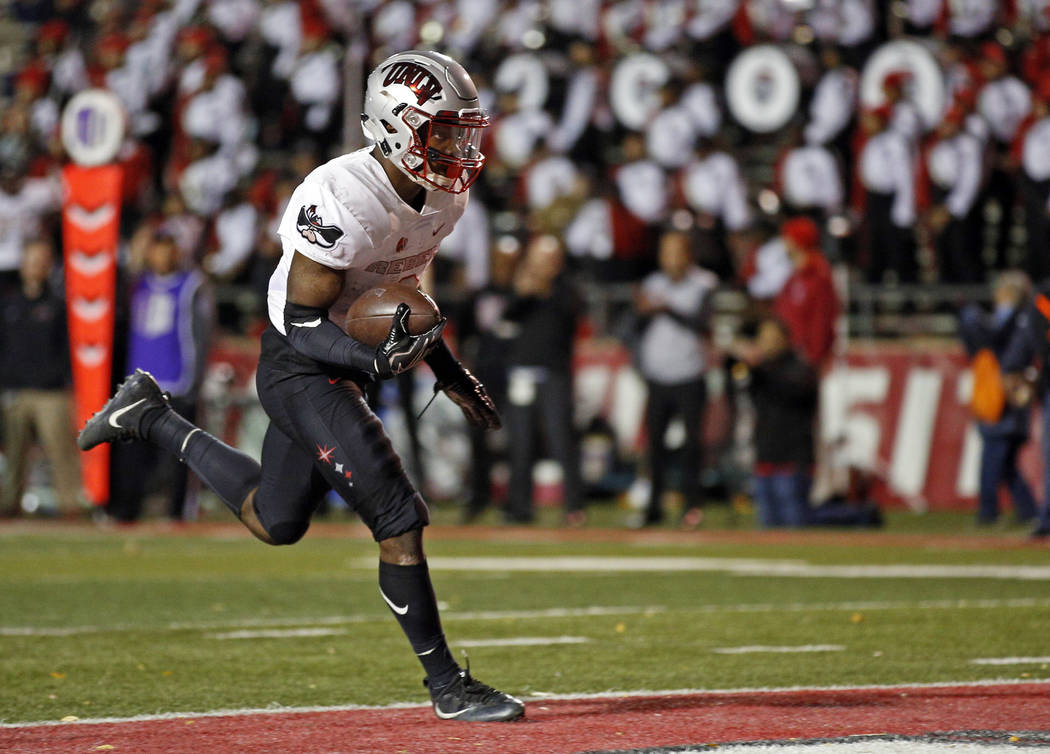 UNLV running back Lexington Thomas scores a touchdown during the first half of an NCAA college football game against New Mexico in Albuquerque, N.M., Friday, Nov. 17, 2017. (AP Photo/Andres Leighton)