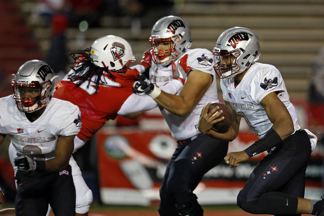 UNLV quarterback Armani Rogers, right, runs to the end zone for a touchdown during the first half of an NCAA college football game against New Mexico in Albuquerque, N.M., Friday, Nov. 17, 2017. ( ...