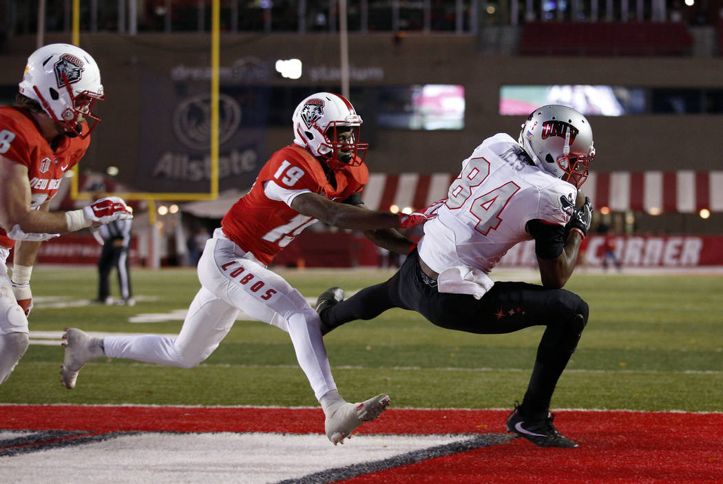 UNLV wide receiver Kendal Keys (84) catches a pass in the end zone to score the go-ahead touchdown as New Mexico cornerback Elijah Lilly (19) defends during the second half of an NCAA college foot ...