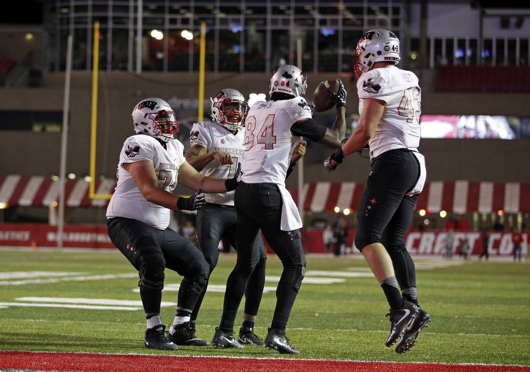 UNLV wide receiver Kendal Keys (84) celebrates with teammates after scoring the go-ahead touchdown against New Mexico during the second half of an NCAA college football game in Albuquerque, N.M.,  ...