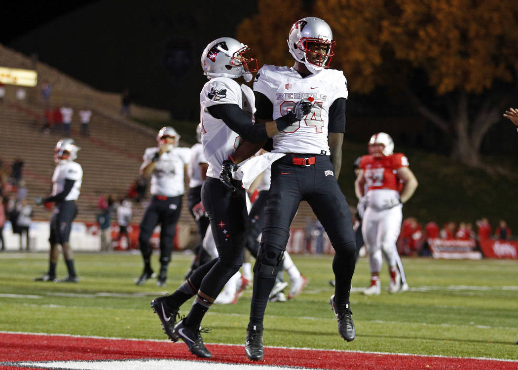 UNLV wide receiver Kendal Keys, right, celebrates with a teammate after scoring the go-ahead touchdown against New Mexico during the final minute of an NCAA college football game in Albuquerque, N ...