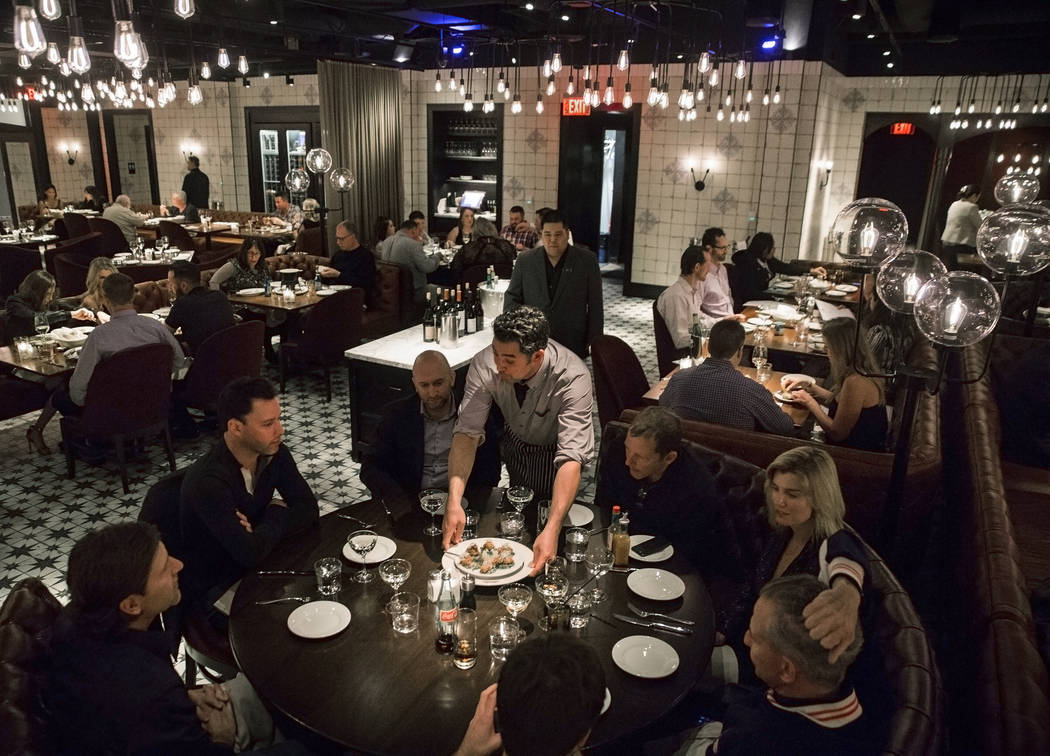 Dinner guests are served at Blue Ribbon on Saturday, Nov. 18, 2017, at The Cosmopolitan, in Las Vegas.  Benjamin Hager Las Vegas Review-Journal @benjaminhphoto