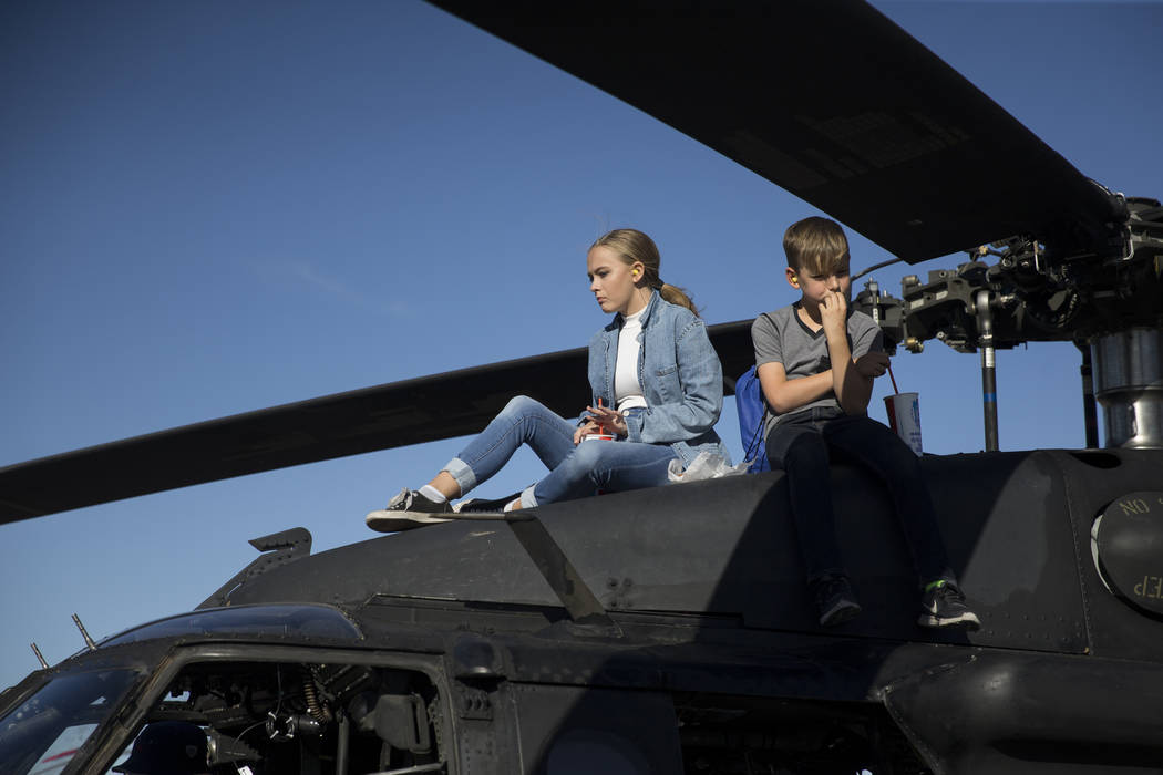 Shela Aldis, left, 15, and her friend Tyler Hollar, 11, sit on top of a MH-60M assault helicopter during Aviation Nation at Nellis Air Force Base in Las Vegas, Saturday, Nov. 11, 2017. Erik Verduz ...