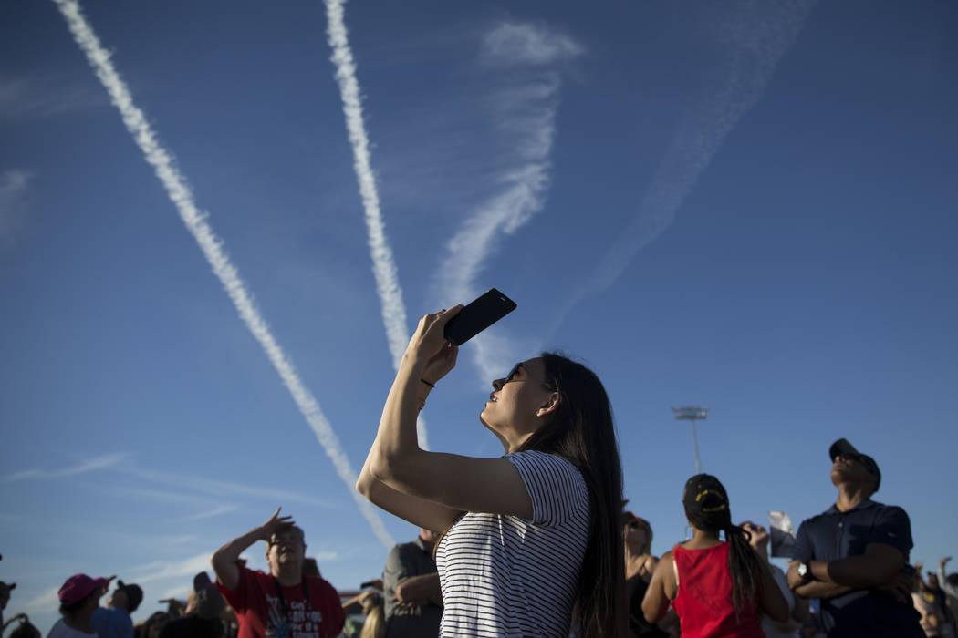 Gina Gross of Las Vegas watches the Thunderbirds perform during Aviation Nation at Nellis Air Force Base in Las Vegas, Saturday, Nov. 11, 2017. Erik Verduzco Las Vegas Review-Journal @Erik_Verduzco