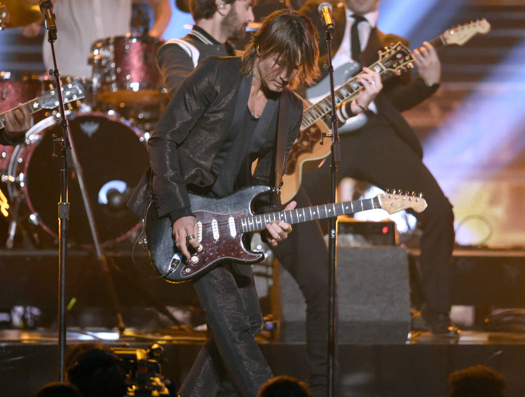 Keith Urban performs at the 51st annual CMA Awards at the Bridgestone Arena on Wednesday, Nov. 8, 2017, in Nashville, Tenn. (Photo by Chris Pizzello/Invision/AP)