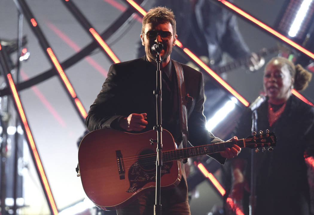 "Eric Church performs ""Chattanooga Lucy"" at the 51st annual CMA Awards at the Bridgestone Arena on Wednesday, Nov. 8, 2017, in Nashville, Tenn. (Photo by Chris Pizzello/Invision/AP)"