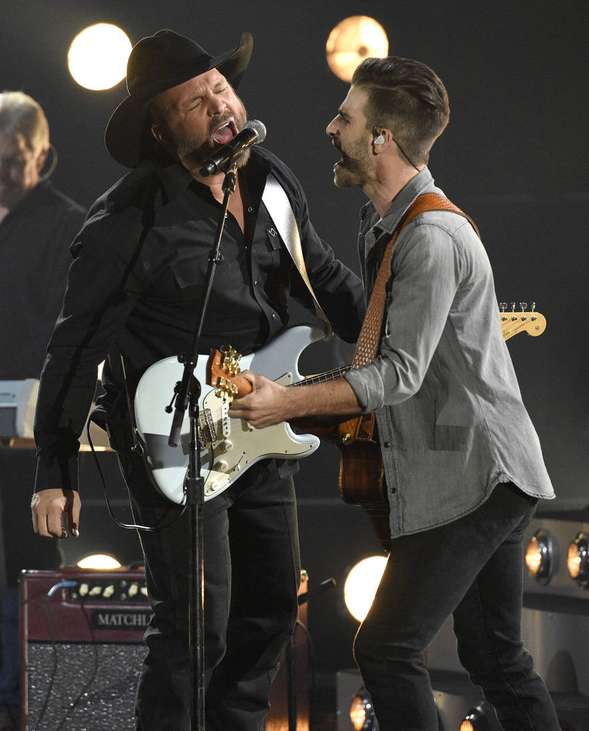 "Garth Brooks, left, performs ""Ask Me How I Know"" at the 51st annual CMA Awards at the Bridgestone Arena on Wednesday, Nov. 8, 2017, in Nashville, Tenn. (Photo by Chris Pizzello/I ..."
