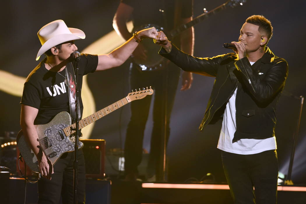 "Brad Paisley, left, and Kane Brown perform ""Heaven South"" at the 51st annual CMA Awards at the Bridgestone Arena on Wednesday, Nov. 8, 2017, in Nashville, Tenn. (Photo by Chris P ..."