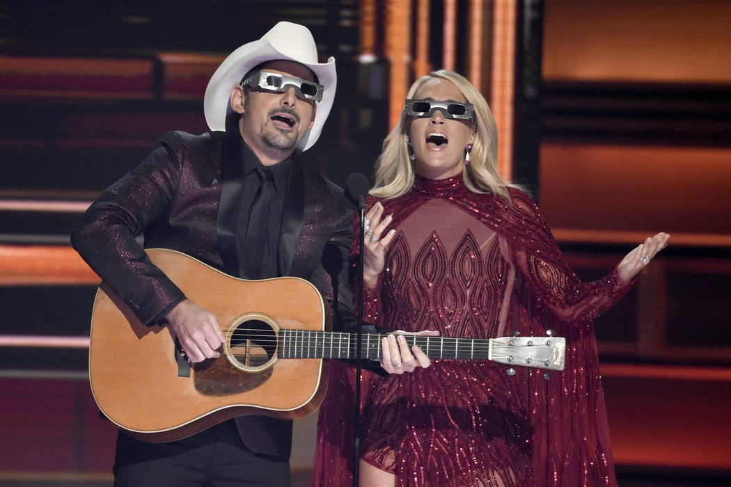 Hosts Brad Paisley, left, and Carrie Underwood speak during the 51st annual CMA Awards at the Bridgestone Arena on Wednesday, Nov. 8, 2017, in Nashville, Tenn. (Photo by Chris Pizzello/Invision/AP)