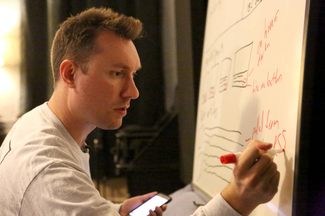 At his home office in Las Vegas on Thursday, Nov. 9, 2017, Mike Ziethlow diagrams his concept in preparation for Startup Weekend where entrepreneurs network, form teams and give a presentation. Mi ...
