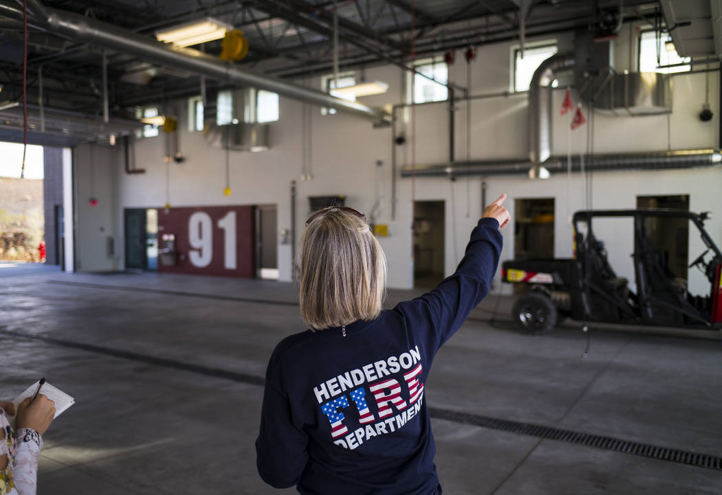 Henderson Fire Department spokeswoman Kathleen Richards talks about the apparatus bay during a tour of Fire Station 91 in Henderson on Friday, Nov. 10, 2017. The new facility is the 10th fire stat ...