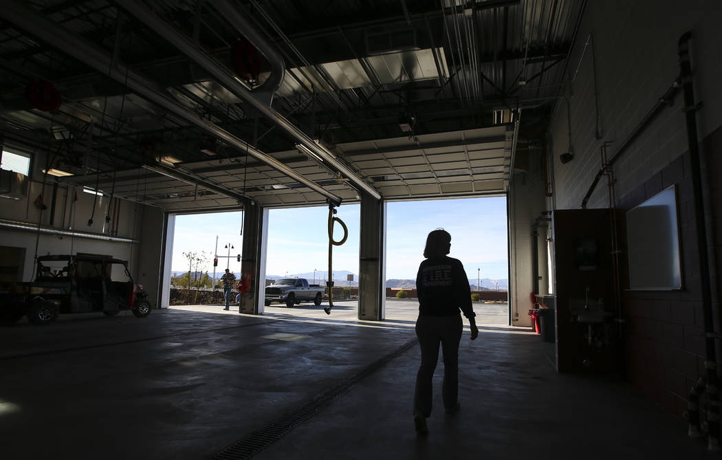 Henderson Fire Department spokeswoman Kathleen Richards is silhouetted in the apparatus bay during a tour of Fire Station 91 in Henderson on Friday, Nov. 10, 2017. The new facility is the 10th fir ...