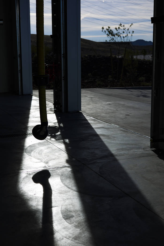 A tube for engine exhaust casts a shadow during a tour of Fire Station 91 in Henderson on Friday, Nov. 10, 2017. The new facility is the 10th fire station in Henderson, serving the Inspirada and M ...