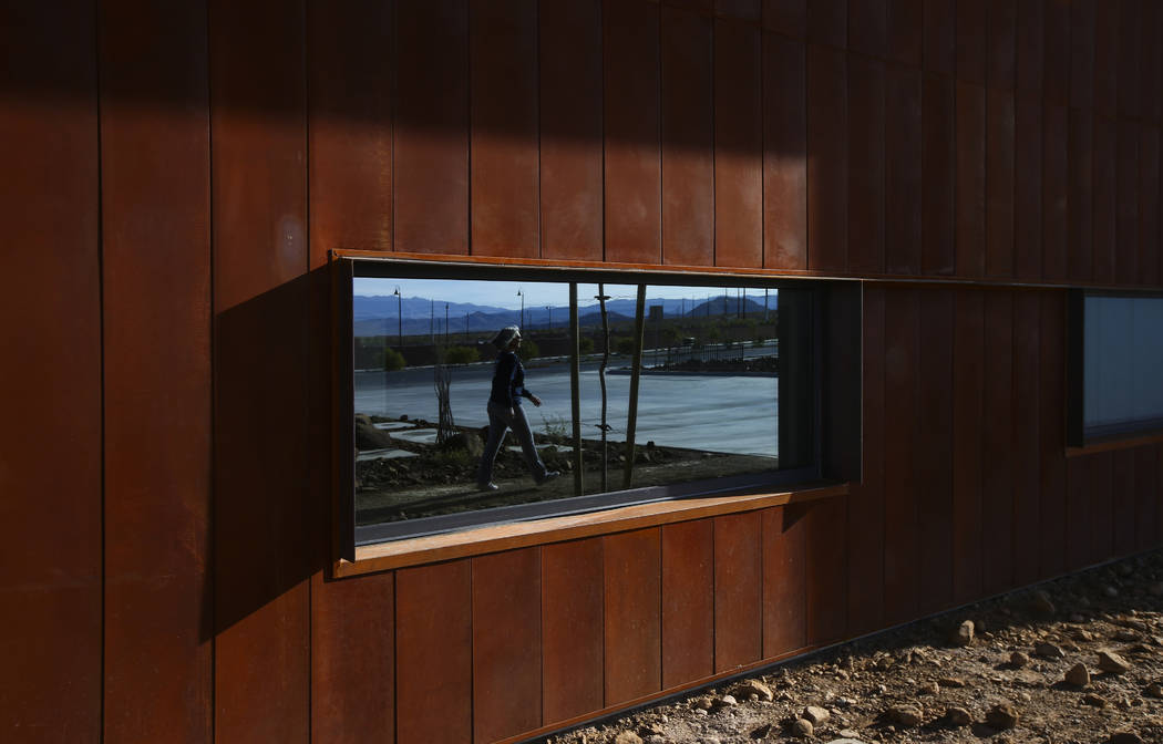 Henderson Fire Department spokeswoman Kathleen Richards, reflected in the window, leads a tour of Fire Station 91 in Henderson on Friday, Nov. 10, 2017. The new facility is the 10th fire station i ...