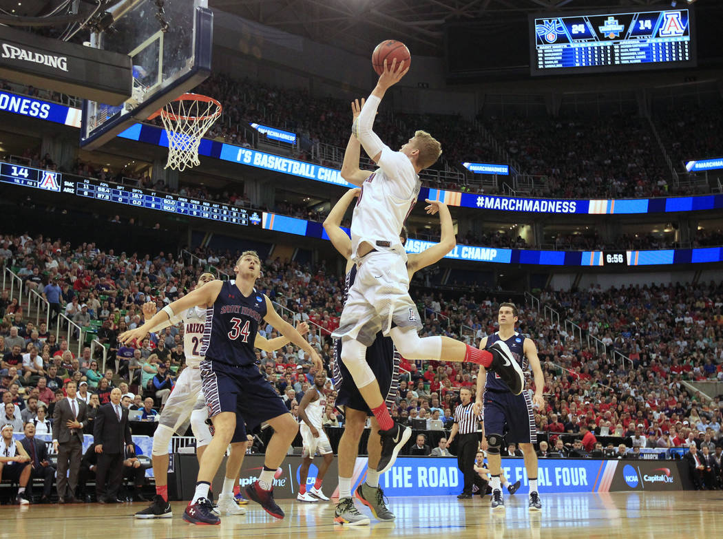 Arizona forward Lauri Markkanen (10) shoots the ball as Saint Mary's center Jock Landale (34) blocks out for the rebound during the first half of a second-round college basketball game in the men' ...