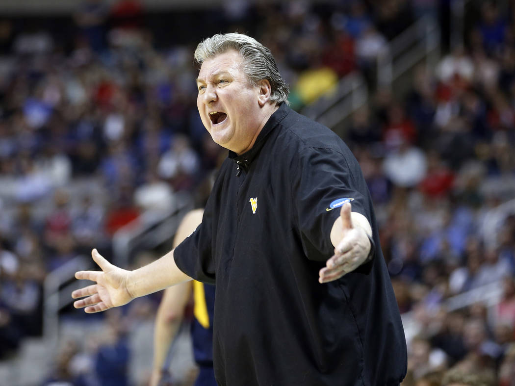 West Virginia head coach Bob Huggins yells from the sideline during the first half of an NCAA Tournament college basketball regional semifinal game against Gonzaga Thursday, March 23, 2017, in San ...