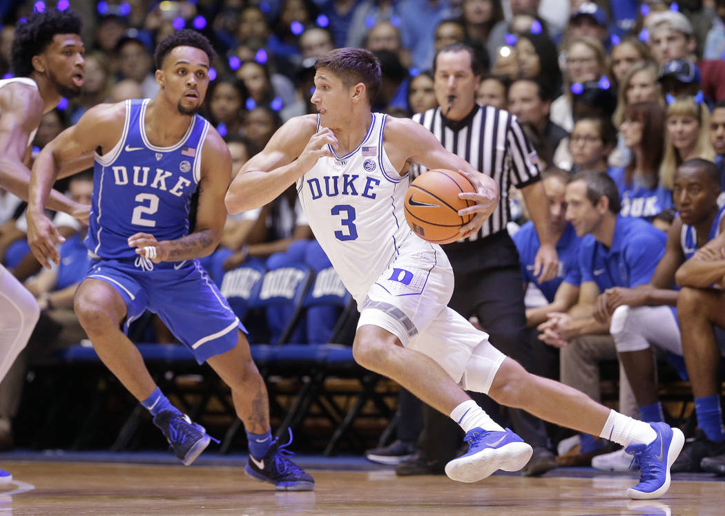 Duke's Grayson Allen (3) dribbles while Gary Trent Jr. (2) defends during the Blue-White scrimmage in the NCAA college basketball team's Countdown to Craziness event to kick off the season in Durh ...