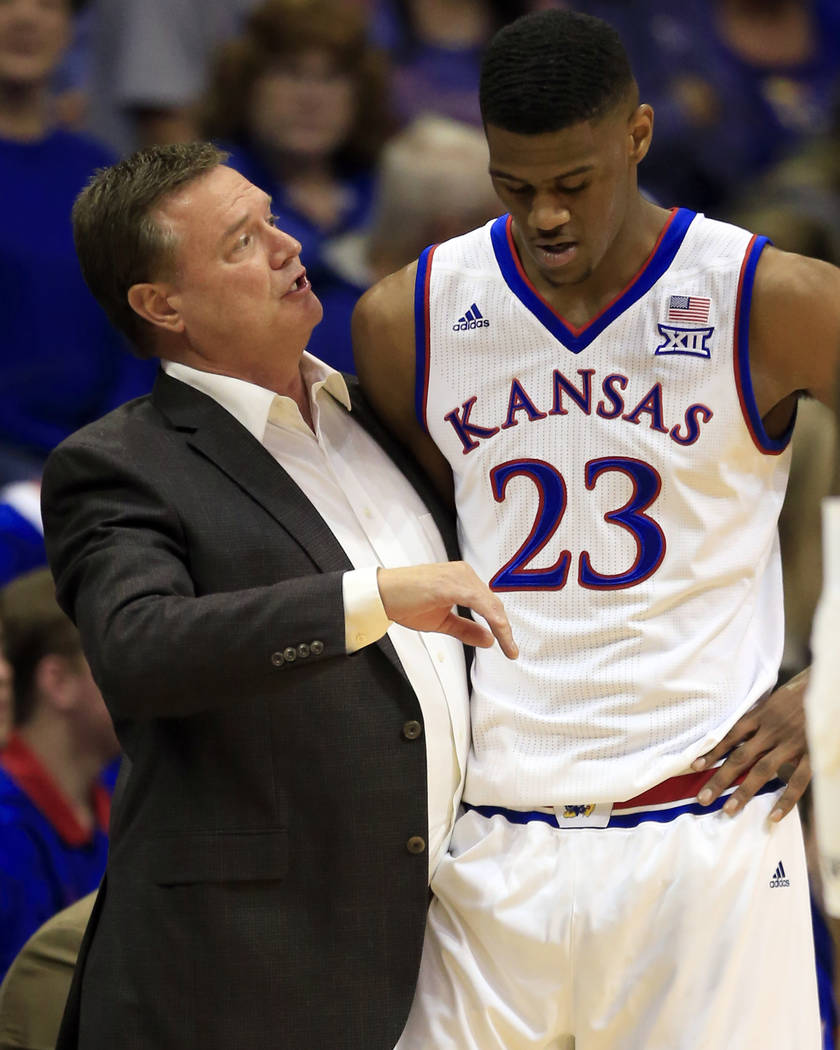 Kansas head coach Bill Self, left, talks with Kansas forward Billy Preston (23) during the first half of an exhibition NCAA college basketball game against Pittsburg State in Lawrence, Kan., Tuesd ...