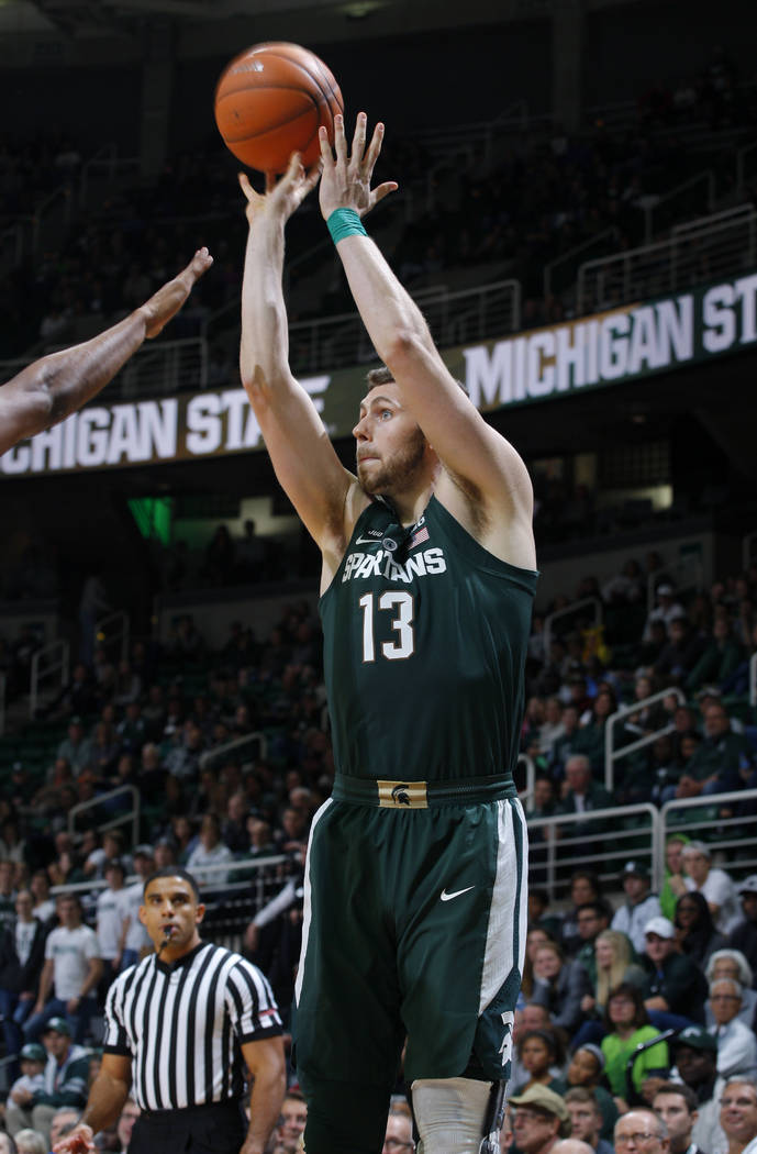 Michigan State's Ben Carter shoots a 3-pointer against Hillsdale during the second half of an NCAA college basketball exhibition game, Friday, Nov. 3, 2017, in East Lansing, Mich. Michigan State w ...