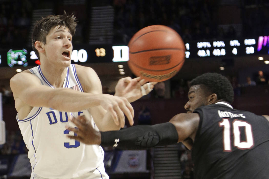 Duke's Grayson Allen (3) passes the ball as South Carolina's Duane Notice (10) defends during the second half in a second-round game of the NCAA men's college basketball tournament in Greenville,  ...