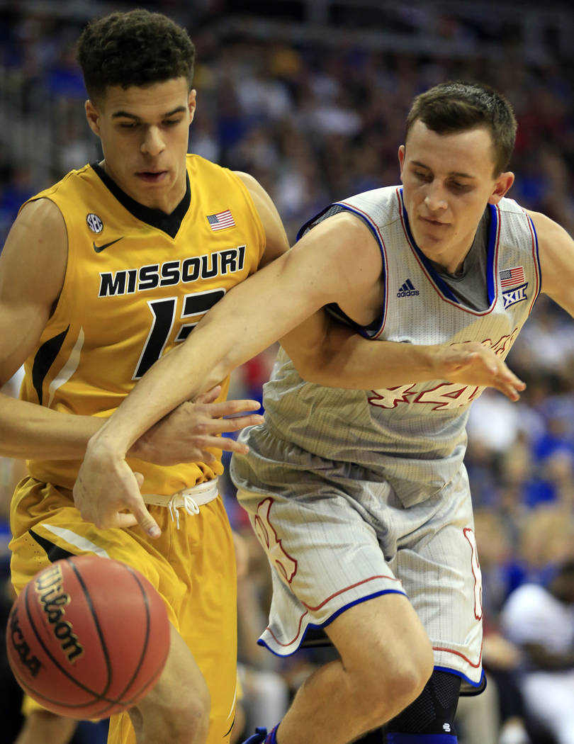 Kansas forward Mitch Lightfoot (44) reaches for the ball in front of Missouri forward Michael Porter Jr. (13) during the first half of an exhibition NCAA college basketball game in Kansas City, Mo ...