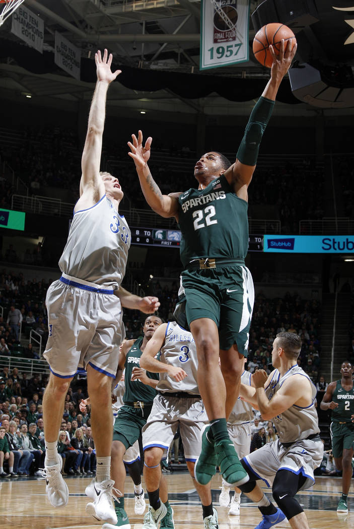 Michigan State's Miles Bridges, right, puts up a shot against Hillsdale's Gordon Behr during the first half of an NCAA college basketball exhibition game, Friday, Nov. 3, 2017, in East Lansing, Mi ...