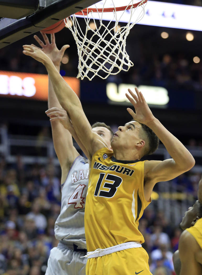FILE - In this Oct. 22, 2017, file photo, Missouri forward Michael Porter Jr. rebounds during the first half of an exhibition NCAA college basketball game against Kansas in Kansas City, Mo. Porter ...