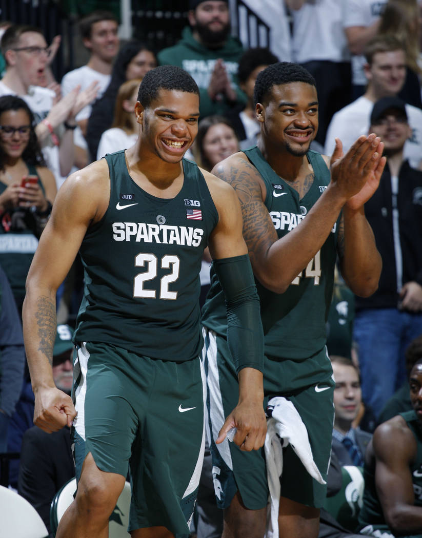 Michigan State's Miles Bridges (22) and Nick Ward celebrate during the second half of an NCAA college basketball exhibition game against Hillsdale, Friday, Nov. 3, 2017, in East Lansing, Mich. (AP ...