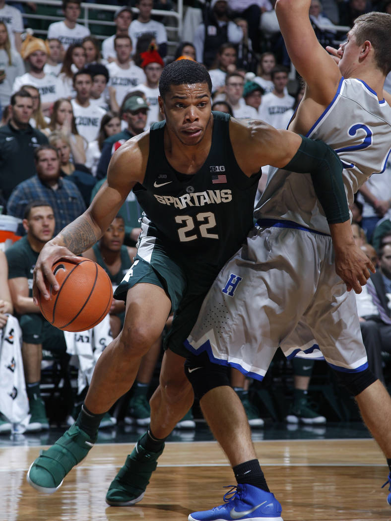 Michigan State's Miles Bridges (22) drives against Hillsdale's Ryan Badowski (2) during the second half of an NCAA college basketball exhibition game, Friday, Nov. 3, 2017, in East Lansing, Mich.  ...