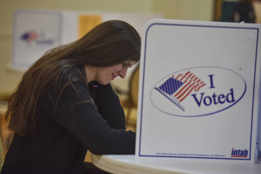 Danica Roem, right, who defeated GOP incumbent Robert Marshall for a seat in the Virginia house of delegates, casts her vote at Buckhall Volunteer Fire Department on Tuesday, Nov. 7, 2017, in Mana ...