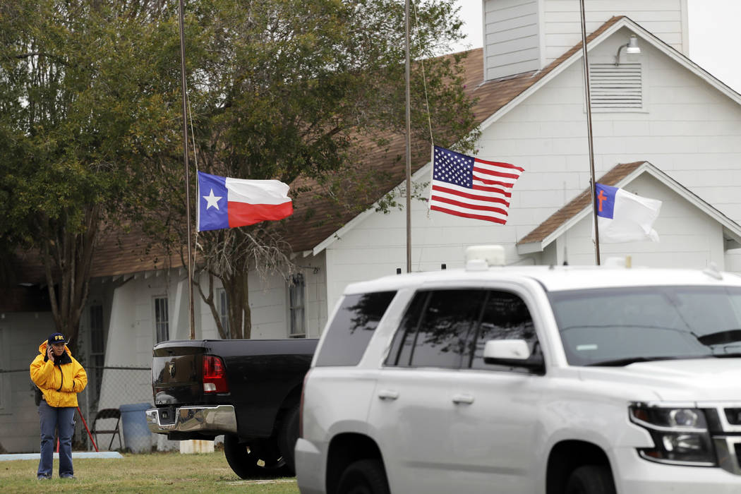 A law enforcement official continues to work the shooting scene at the First Baptist Church Wednesday, Nov. 8, 2017, in Sutherland Springs, Texas. A man opened fire inside the church in the small  ...