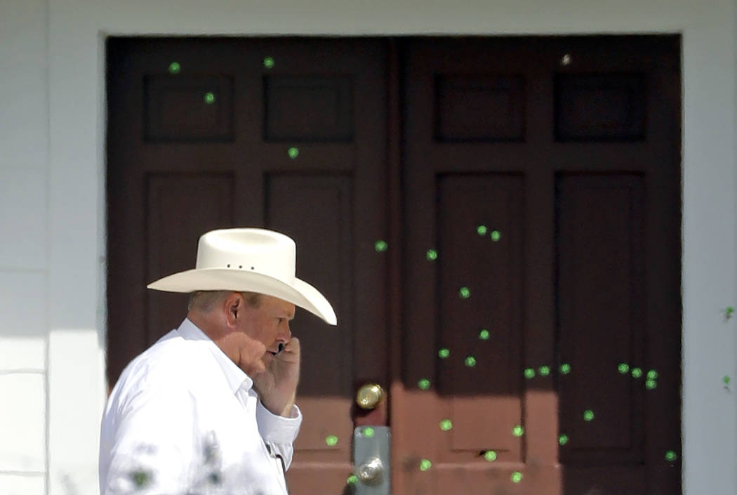 Wilson County Sheriff Joe Tackitt Jr. walks past the front doors where bullet holes were marked by police at the First Baptist Church, Tuesday, Nov. 7, 2017, in Sutherland Springs, Texas. A man op ...